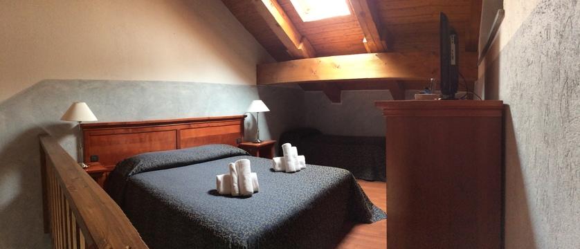 italy_milky-way-ski-area_claviere_hotel-clari_bedroom.jpeg